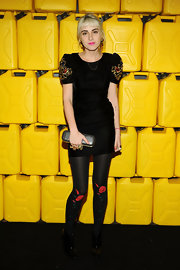 Idil Tabanca wore flower-embellished tights with her LBD for a playful touch.