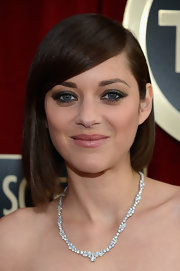 Marion Cotillard opted for a simple diamond necklace at the 19th Annual Screen Actors Guild Awards.