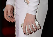 Mireille Enos carried a hard case purse from Swarovski at the 'Gangster Squad' premiere.