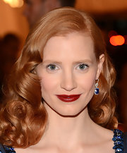 Jessica Chastain paired Harry Winston dangling gemstone earrings with a retro-glam hairstyle for the Met Gala.