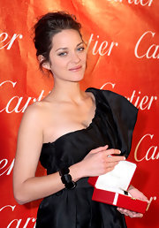 Marion Cotillard paired a chunky beaded bracelet with a one-shoulder LBD for the Palm Springs International Film Festival.