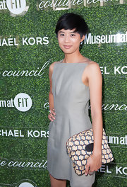 Kim Nguyen complemented her plain dress with a printed clutch when she attended the Couture Council Fashion Visionary Awards.