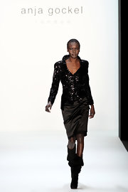 A pair of slouchy black boots finished off Alek Wek's look in edgy-glam style.