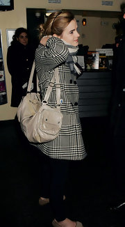 Emma Watson paired a small duffle by All Saints with a black-and-white houndstooth coat for the 'Ano Una' premiere.