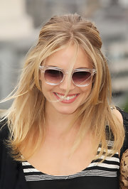 Sienna Miller styled her look with a pair of clear-rimmed sunnies by Benjamin.