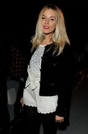Sienna Miller attended the Matthew Williamson fashion show looking cute in scalloped white paperbag shorts by Chloe.