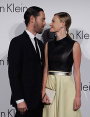 Kate Bosworth was minimalist-elegant in two-tone leather dress styled with a chain-embellished box clutch, both by Calvin Klein, during the 'Infinite Loop' exhibition.