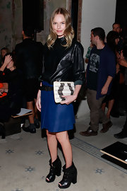Kate Bosworth finished off her ensemble with a tricolor patterned clutch.