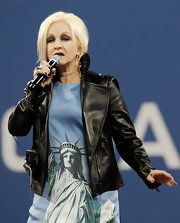 Cyndi Lauper performed the US national anthem wearing a Lady Liberty printed dress and a leather jacket.