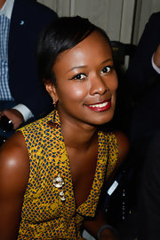 Shala Monroque's dangling gold hammer earrings at the Valentino show were equal parts fun and chic.