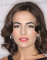 Camilla Belle paired David Yurman diamond hoops with a curly 'do for total sophistication at the private pre-Oscar dinner.