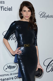 Caroline Sieber paired a multifaceted black satin clutch with a shimmery dress for the Soiree Chopard Mystery Party.