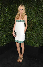 Poppy Delevinge styled stand-out gold sandals at the Chanel Pre-Oscar dinner.