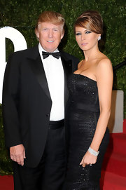 Melania Trump looked totally glam wearing this diamond bracelet and strapless gown combo at the 2011 Vanity Fair Oscar party.