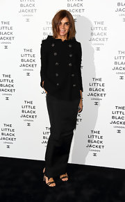 Carine Roitfeld showed off her classic style with this black funnel-neck pea coat and long skirt combo during the Chanel Little Black Jacket private view.