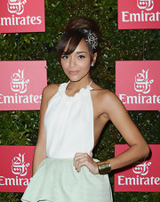 Ashley Madekwe accessorized with a wide gold cuff by Karine Sultan during the Melbourne Cup.
