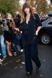 Lou Doillon kept it classic in a navy pantsuit by Chanel when she attended the label's fashion show.