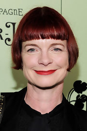 Sandy Powell attended the 2011 Women in Film pre-Oscar cocktail party wearing a short cut with blunt bangs.