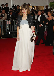 Lou Doillon finished off her red carpet look with an embellished black frame clutch.