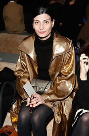 Giovanna Battaglia went for total shimmer at the Reed Krakoff fashion show, teaming a metallic Chanel purse with a gold coat.