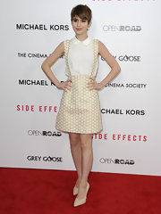 Sami Gayle paired her cute skirt with a sleeveless white Miu Miu blouse featuring a crystal-embellished collar.