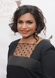 Mindy Kaling glammed it up with this loose updo for the 2013 WGAw Writers Guild Awards.