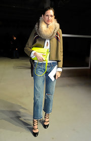 Jenna Lyons complemented her outfit with a neon-yellow satchel for a bright pop of color.