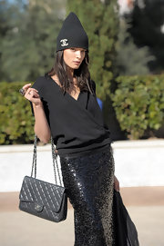Crystal Renn sported a black Chanel beanie at the SI Swimsuit event.