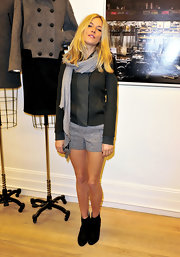 Sienna Miller showed off her legs in gray Rag & Bone tweed shorts while attending the brand's Soho store opening.