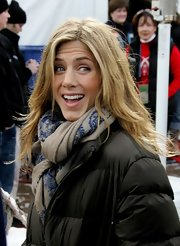 Jennifer Aniston looked extra warm wearing this patterned scarf and puffer jacket combo at Sundance.