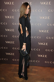 Carine Roitfeld sported an edgy-glam ensemble, consisting of a studded black clutch and a sheer-panel, backless gown, during the Gucci dinner.