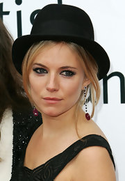 Sienna Miller went for an edgy beauty look with heavily lined eyes.