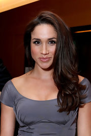 Meghan Markle sported a flippy layered cut at the FINCA Canada fundraiser.