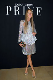 Anna dello Russo twinkled in an elegant sequined peplum dress during the Giorgio Armani Prive fashion show.