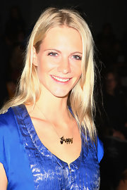 Poppy Delevingne attended the Carlos Miele fashion show wearing her name around her neck.