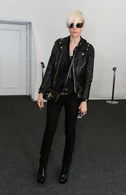 Kate Lanphear topped off her edgy all-black look with a small satchel when she attended Mercedes-Benz Fashion Week.