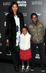 Liya Kebede added more warmth with a pair of opaque black tights.