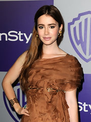 Lily Collins styled her one-shoulder dress with a metal belt for the Warner Brothers and InStyle Golden Globe after-party.