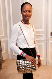Shala Monroque went for a sporty feel in a white crewneck sweater with red and blue trim during the Dorchester Collection Fashion Prize launch.