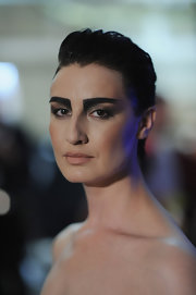 Erin O'Connor posed backstage at the Hannah Marshall fashion show wearing an edgy fauxhawk and stage makeup.