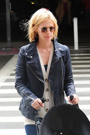 January Jones accessorized with a pair of round shades.