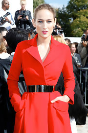 Leelee Sobieski's metal belt provided an elegant finishing touch to her red coat dress at the Dior fashion show.