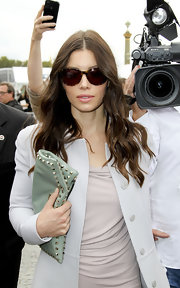Jessica Biel made her way to the Valentino fashion show carrying the brand's iconic Rockstud clutch in mint green.