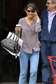 Katie Holmes headed out in New York City wearing a pair of stylish oval sunnies.