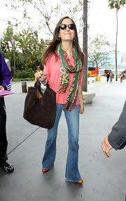 For her arm candy, Camilla Belle chose a brown suede hobo bag by Ralph Lauren.
