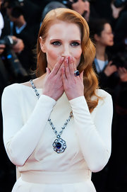 Jessica Chastain styled her white gown with a huge sapphire, diamond, and platinum ring by Bulgari for the Cannes premiere of 'Behind the Candelabra.'