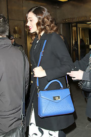 Emmy Rossum was spotted outside the NBC Studios carrying a stylish blue ostrich leather cross-body tote by Kate Spade.