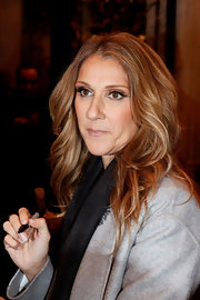 Celine Dion headed out in Paris wearing a stylish wavy 'do.