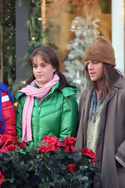 Katy Perry  filmed scenes for 'Saturday Night Live' wearing a pink knit scarf and a green puffer jacket.