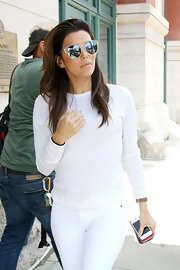 Eva Longoria accessorized with ultra-modern mirrored sunnies for a day out in New York City.